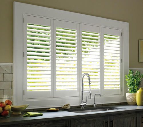 white shutters over kitchen sink